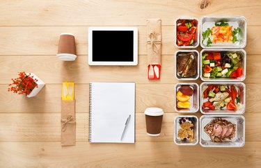 Learning how to meal plan with food and notebook