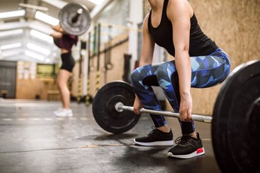 Young woman Preparing for Weightlifting