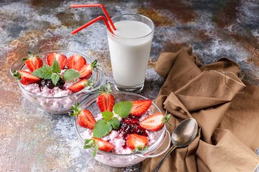 Milk products. Milk, cottage cheese, jam, yogurt with fresh strawberries and mint leaves