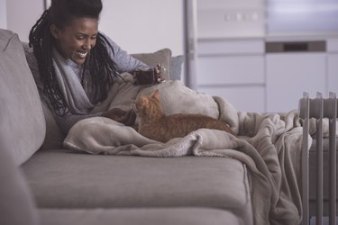 Woman spending time with cat to relieve stress.