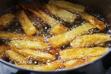 French fries fry in hot bubbling oil