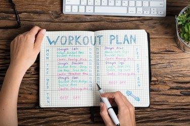Human Hand Preparing Workout Plan