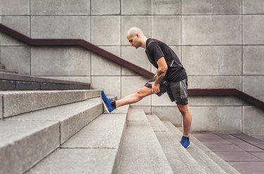 Man Stretching hamstring on stairs With Achilles Tendon Pain