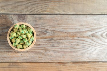 wasabi peas in wood cup. Top view.