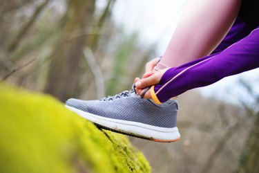 Tying laces before running in nature