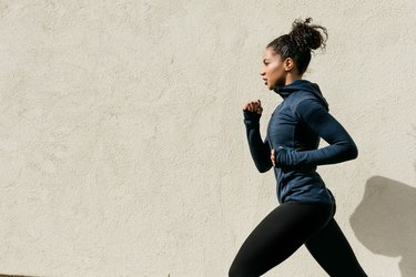 Woman Running Against Wall