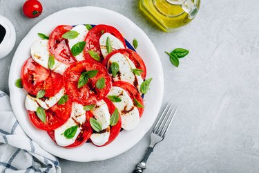 Tomato, basil, mozzarella Caprese salad with balsamic vinegar and olive oil.