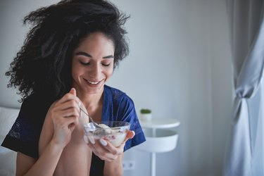 Woman eating gluten-free cereal.