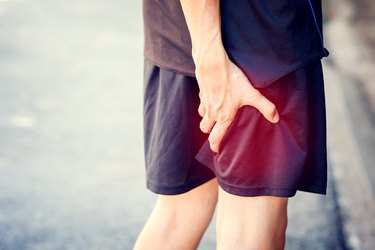 Runner touching painful leg. Athlete runner training accident.