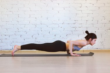 Woman doing Chaturanga pose