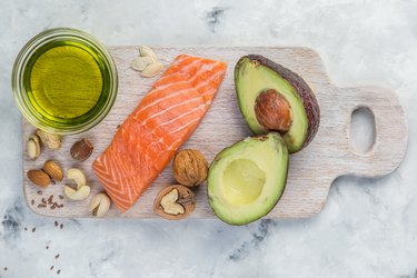 Selection of good fat sources - healthy eating concept. salmon avocado