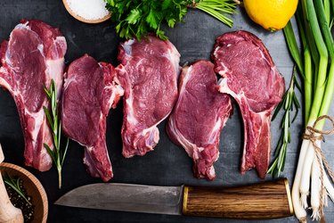 Fresh raw uncooked veal steaks with ingredients