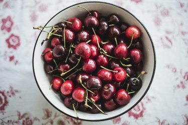 Top view of cherries in a bowl on a table