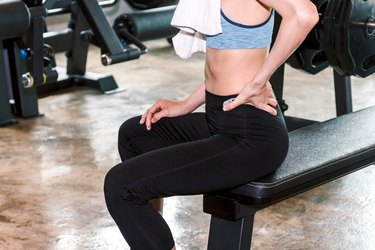 Woman doing exercises for lower back pain