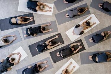 People doing Child's pose on eco-friendly yoga mats