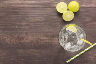 Fresh soda, lime on a wooden background