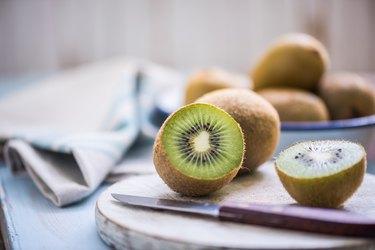 kiwi halves on wooden board