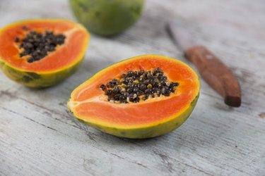 Sliced papaya on wood