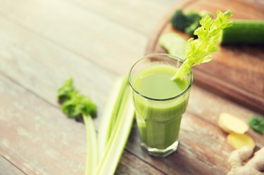 close-up of fresh green juice glass and celery juice