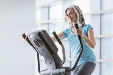 A woman doing an elliptical workout for weight loss