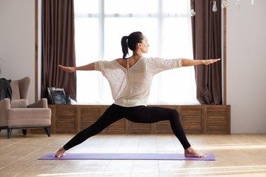 Woman in war pose doing yoga