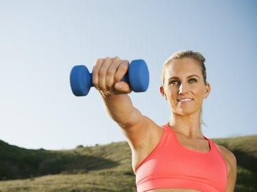 Caucasian woman exercising outdoors