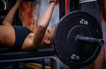 Girl bench press training