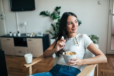 A woman eating a healthy breakfast at home
