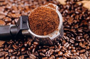 Coffee beans and portafilter for espresso coffee machine