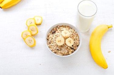 Granola, bananas and a glass of milk