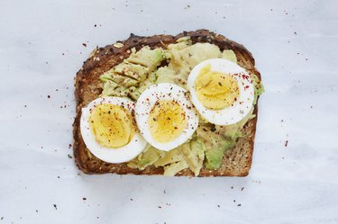Toasted bread with avocado and hard boiled egg