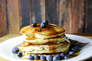 Stack of Blueberry Pancakes with Maple Syrup