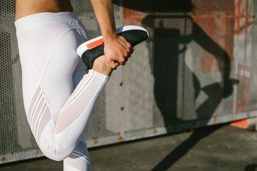 Woman stretching quadriceps