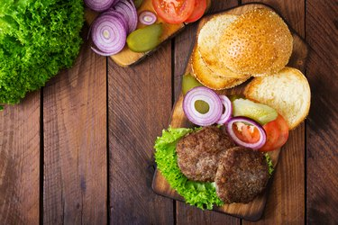 Directly Above Shot Of Burgers On Cutting Board