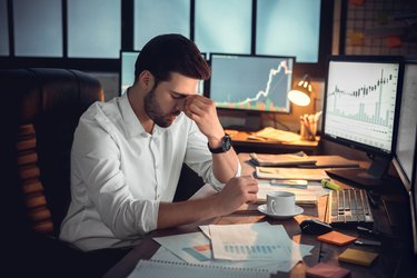 Depressed frustrated trader tired of overwork or stressed by bankruptcy