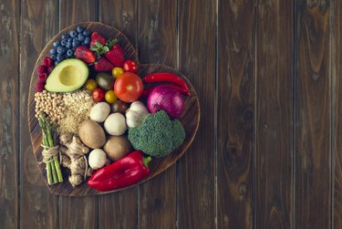 Healthy fruits and veggies on a heart shape cutting board