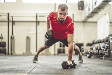 Man is doing cross-training exercise wearing men's workout shorts