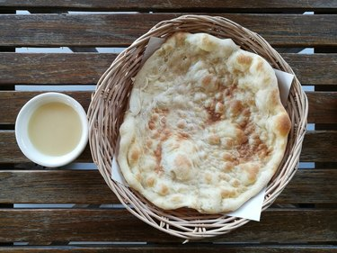 Directly Above Shot Of Roti In Basket On Table
