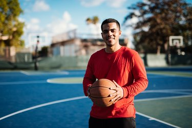 Portrait of Latino guy with basketball ball