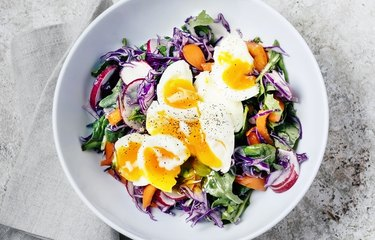 Fresh salad with soft-boiled eggs