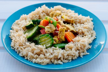 Fried chicken with brown rice and vegetables