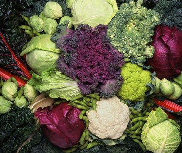 overhead of cruciferous vegetables including broccoli, cauliflower and cabbage