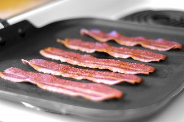 bacon frying in skillet