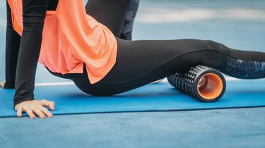 Midsection Of Woman Exercising On Mat