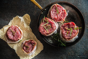 Top of view beef tenderloin steak wrapped in bacon stored into the pan.