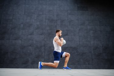 man doing lunges with kettlebell for a butt workout