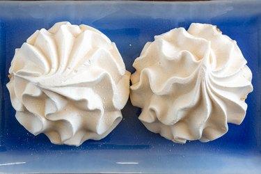 Two baked meringue kisses, sweet food