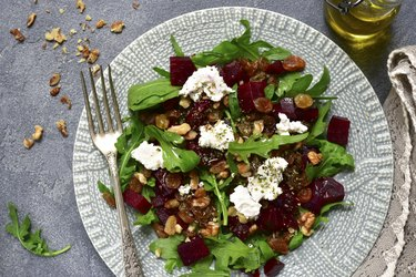 Warm beetroot salad with arugula, raisins and feta