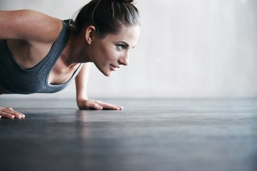 A woman doing pushups to build muscle