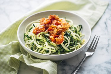 A bowl of fresh Zoodles with tomato sauce
